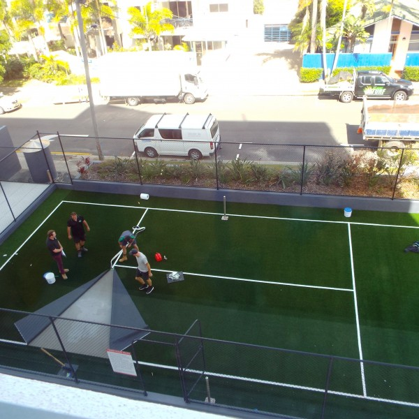 Nearing the end of laying the artificial grass